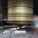 Spinning the prayer wheel at Kopan Monastery, Nepal