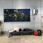 Taking a snooze in the KL airport before our flight to KTM