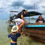 Boarding a longtail boat to Railay Beach